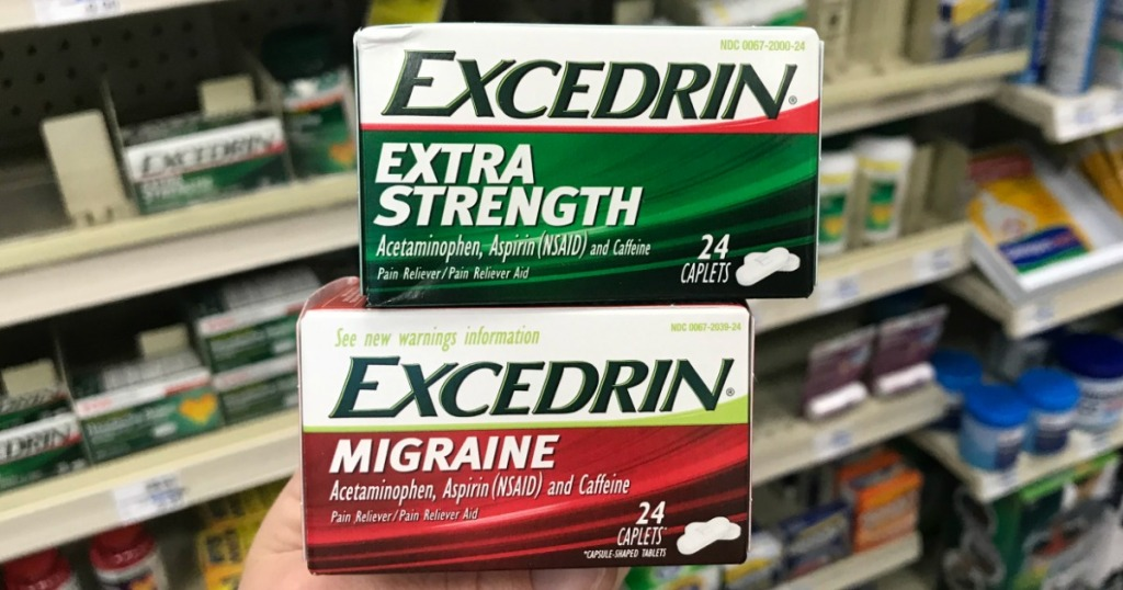 woman holding excedrin