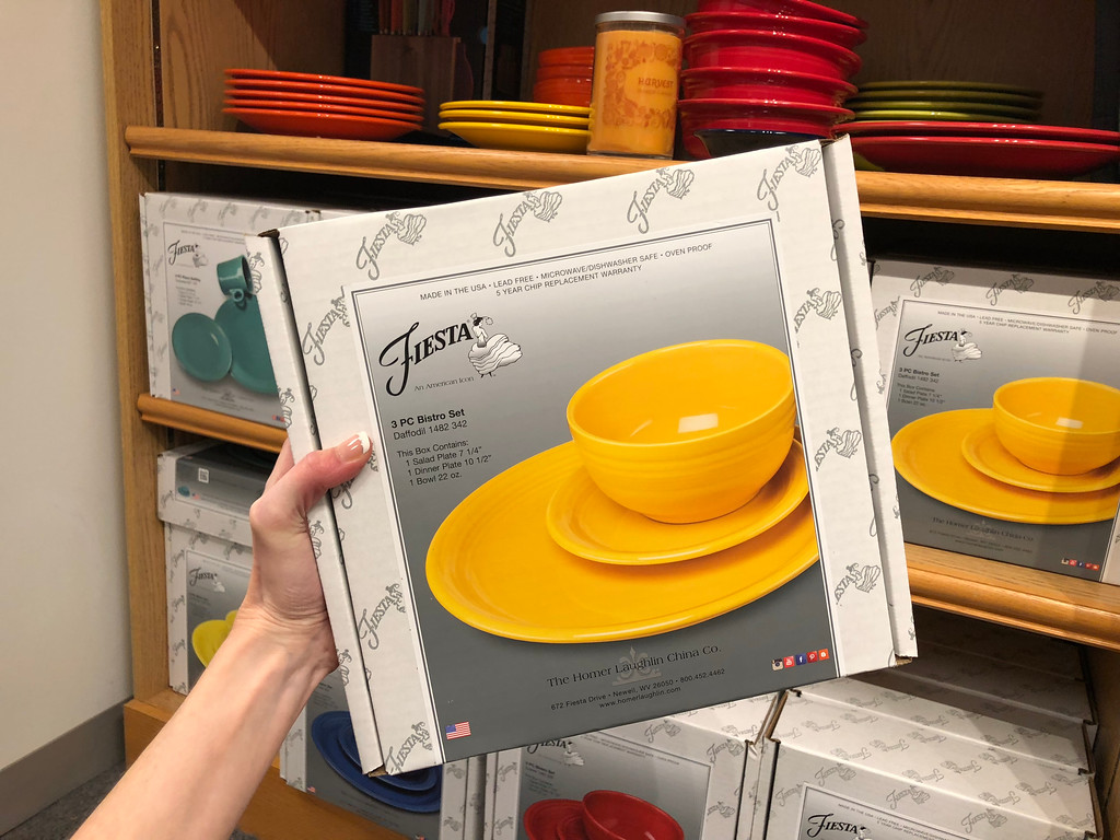 hand holding Fiesta dinnerware set
