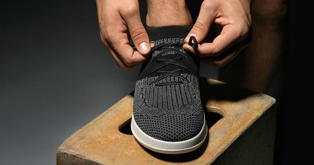 9ccd59c7d98 FitFlop ÜBERKNIT Men's Slip-On High Top Sneakers man tying laces