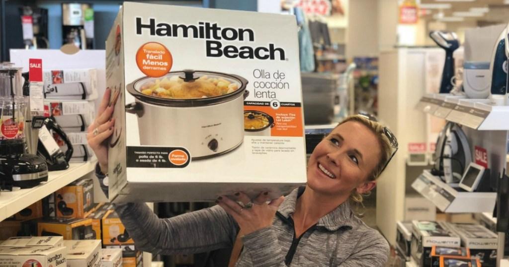Collin holding Hamilton beach crock pot