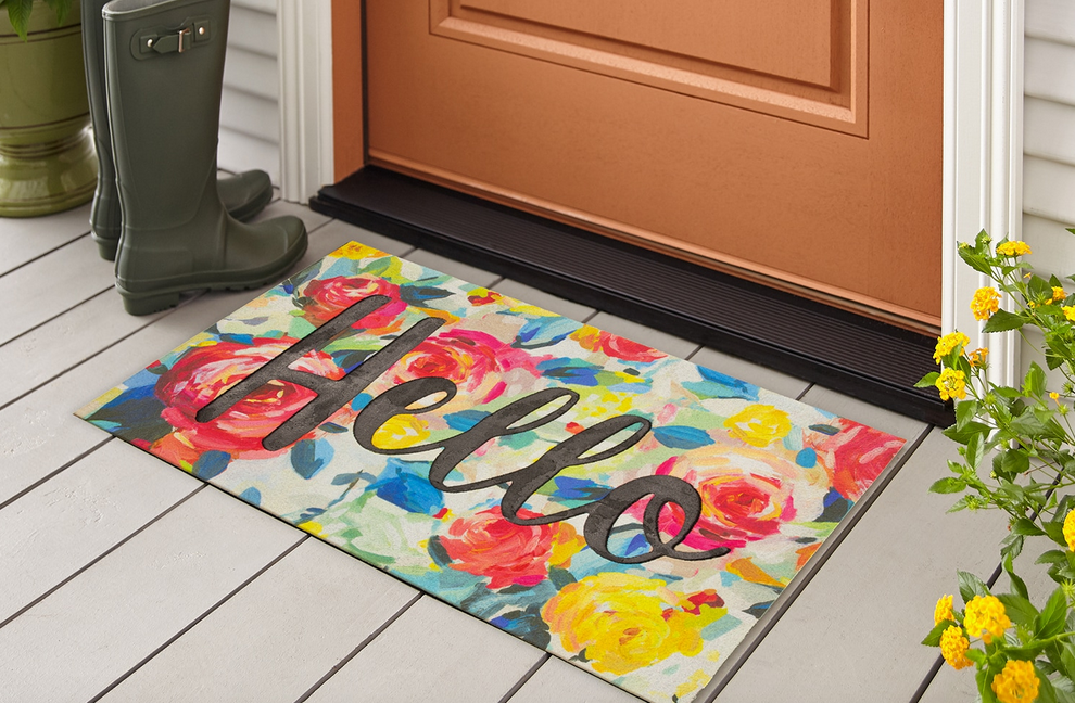 hello Mohawk home doormat near a pair of galoshes