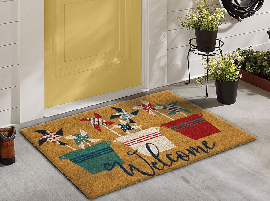pinwheels Mohawk home doormat on a front porch