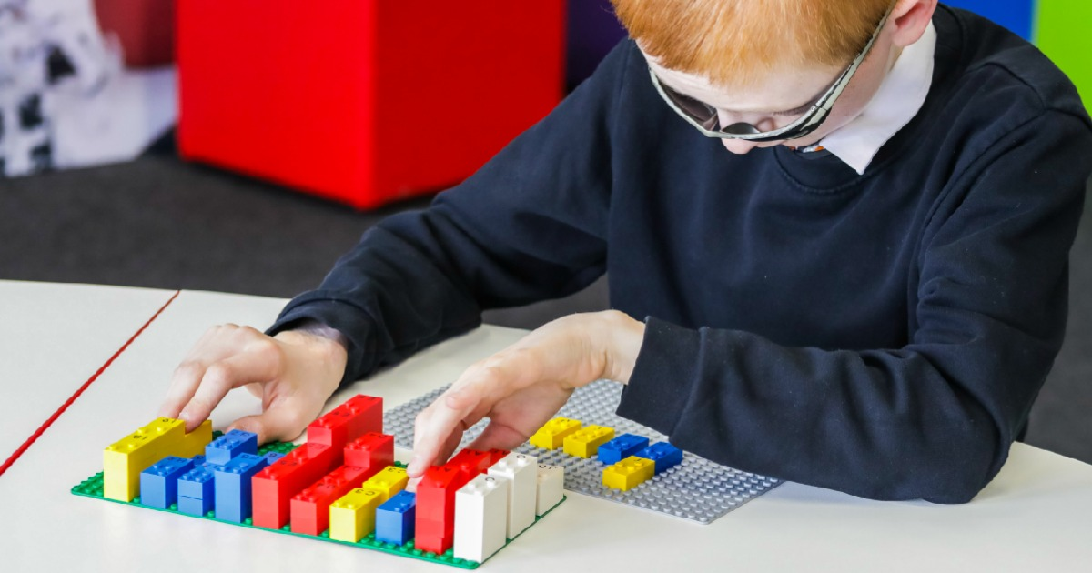 these new Lego Braille brick kits will help kids learn braille like this young boy