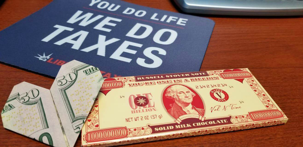 Liberty Tax Online placard and $50 bill folded into a heart
