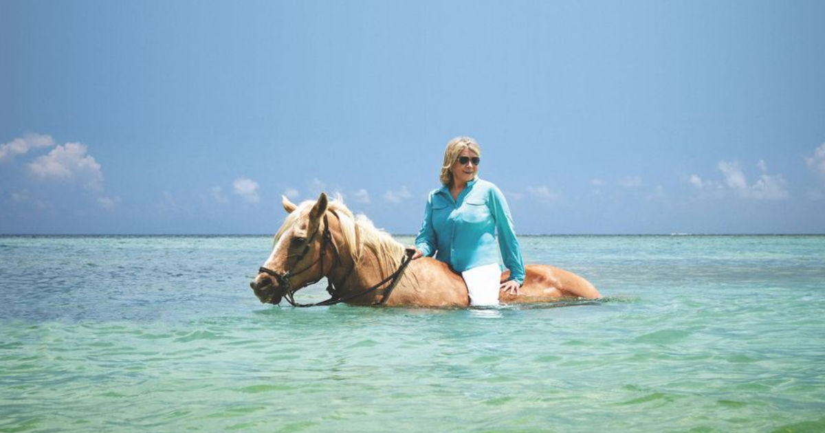 Martha Stewart on horseback in the ocean
