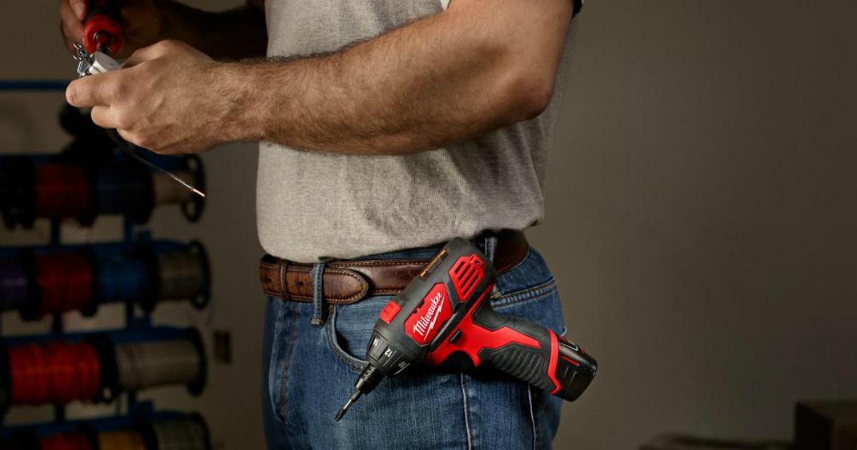 man wearing Milwaukee drill on his belt