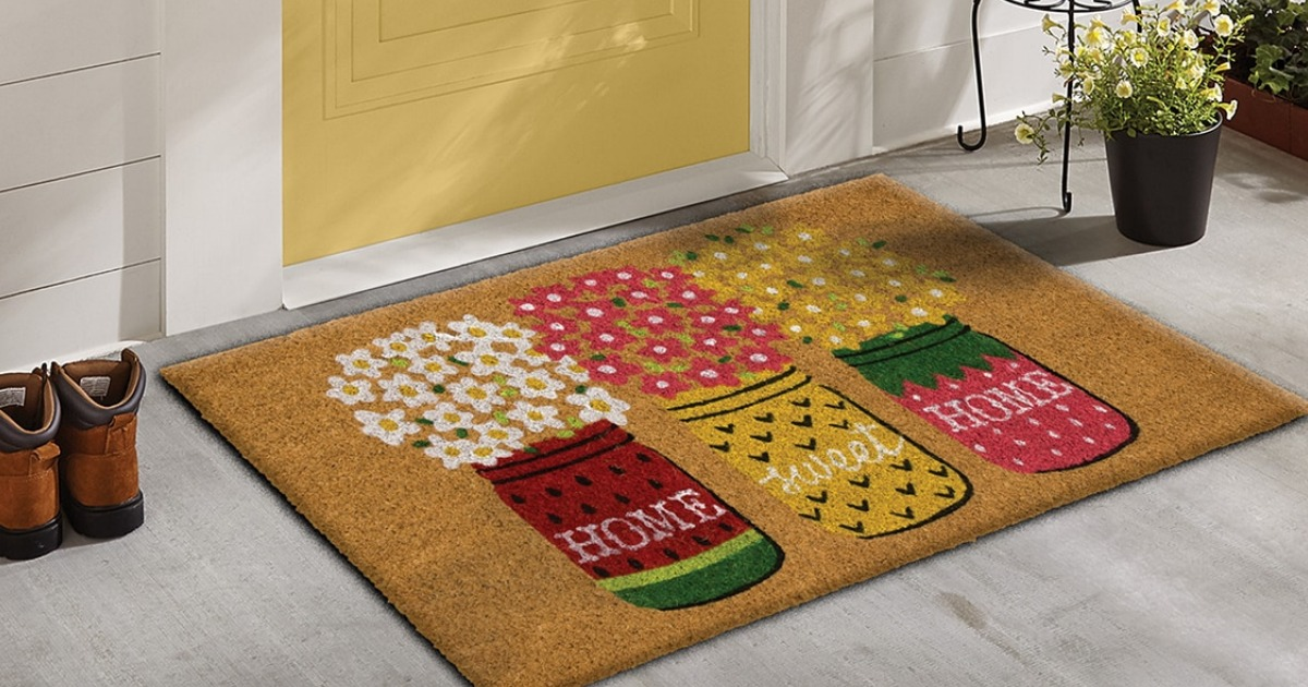 Mohawk home doormat near shoes and flowers