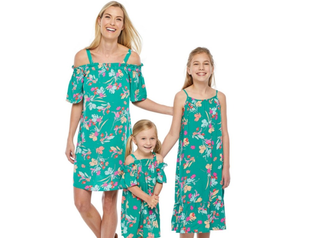 Mom and two girls wearing Mommy and Me Peyton & Parker teal dresses