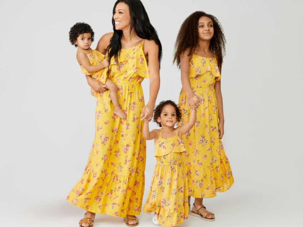 Mom and three girls wearing Mommy and Me Peyton & Parker yellow floral dresses