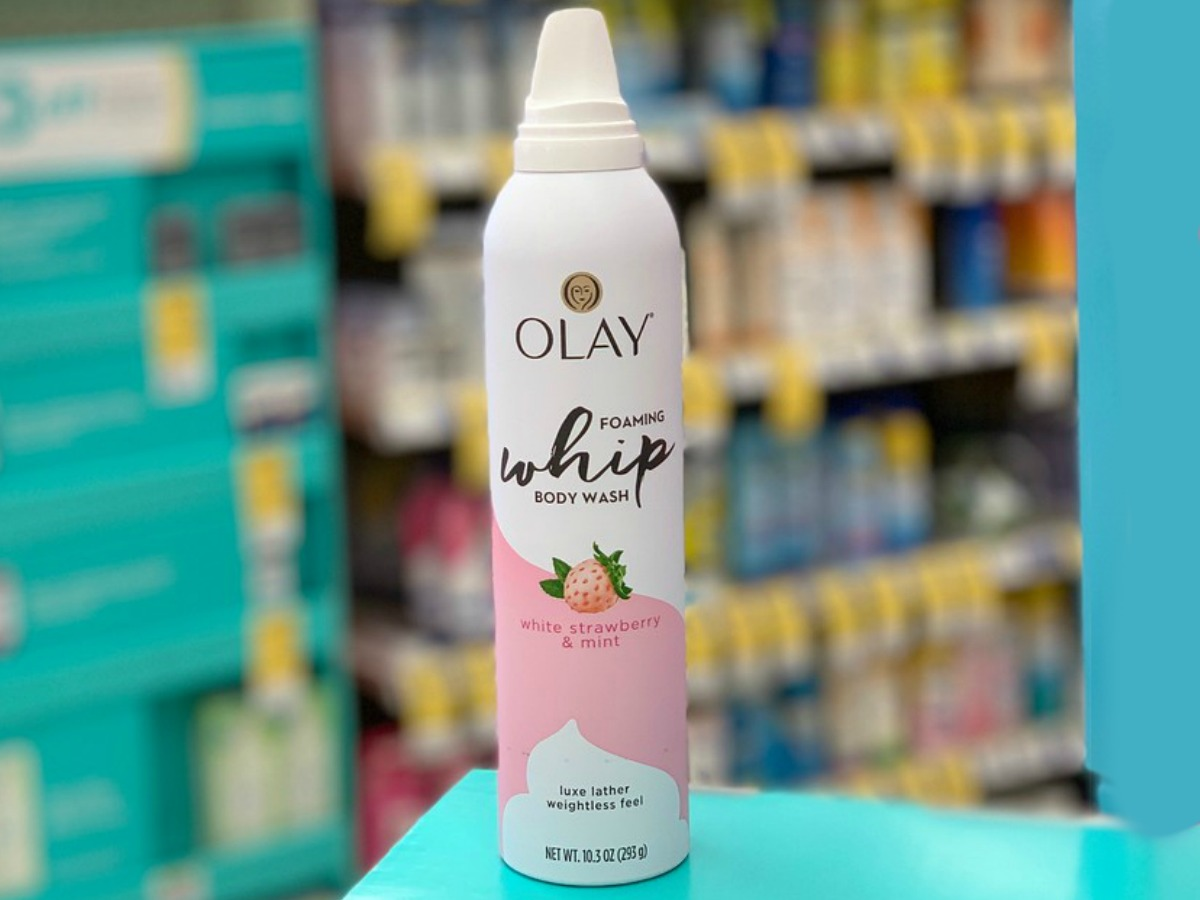 Olay Cooling Foaming Whip Body Wash White Strawberry and Mint on counter at Walgreens