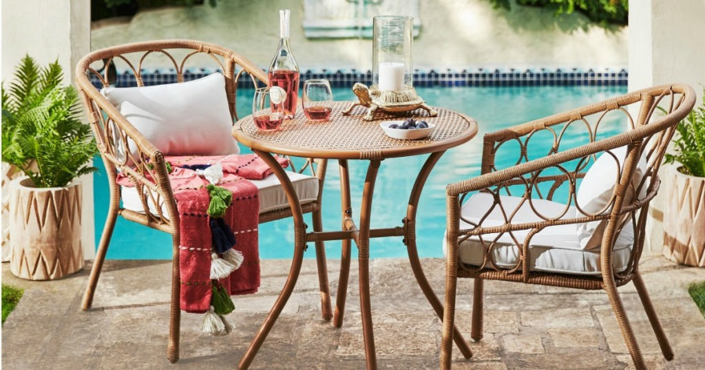 chair and table set next to pool