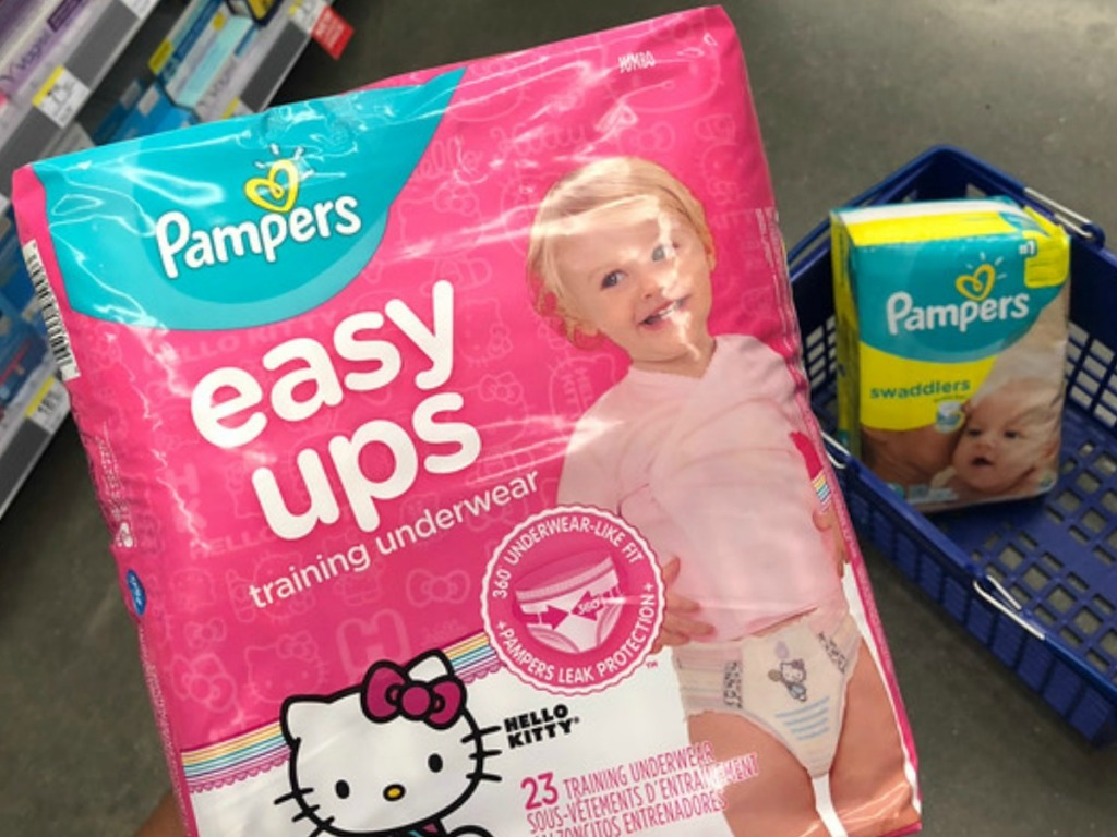 Pampers Easy Ups with Pampers Swaddlers diapers in background