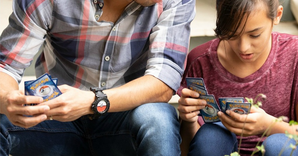 Pokemon Cards in hands of boy and girl