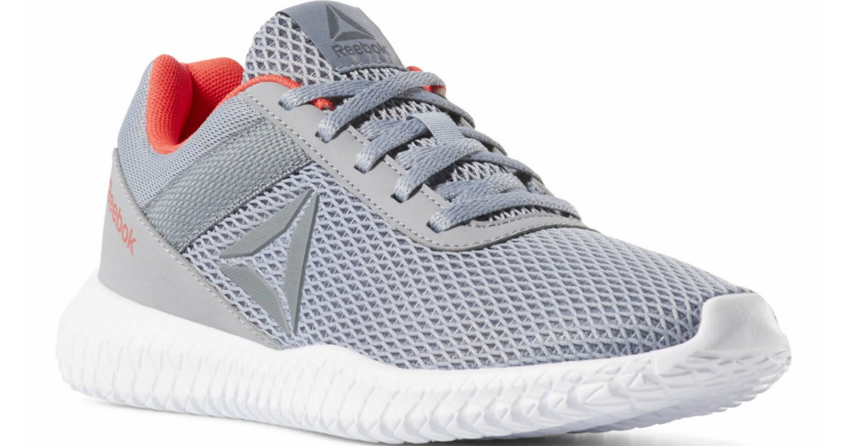 gray mesh Reebok shoes with orange accents