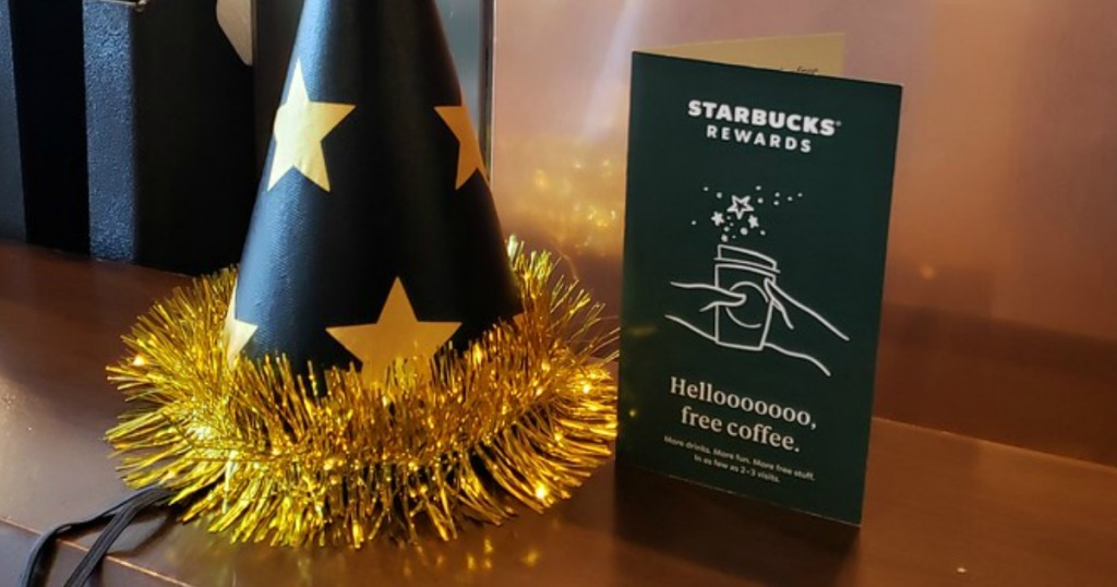 party hat next to Starbucks rewards voucher