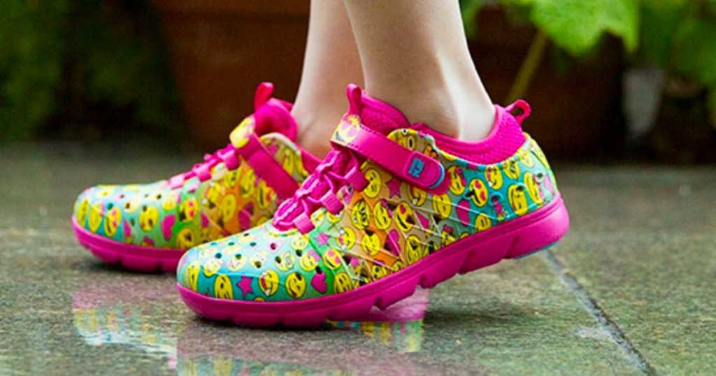 Girl wearing stride rite Pink Emoji Made2Play Phibian Sneaker Sandal