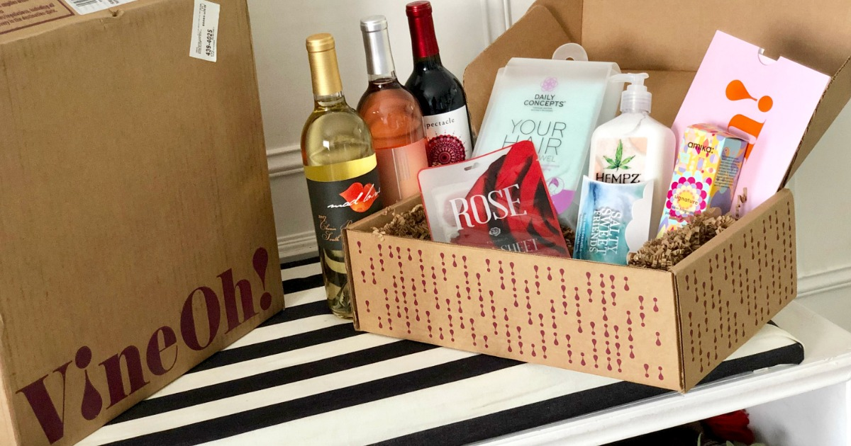 Vine Oh Subscription Box opened up with wine, hand lotion and other items