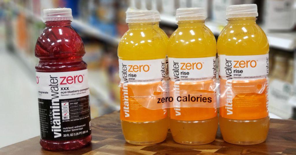 red and orange drink on shelf