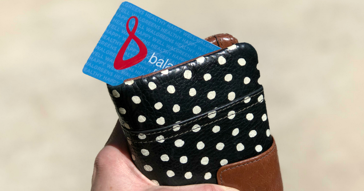 Walgreens Balance Rewards cards peeking out of a wallet