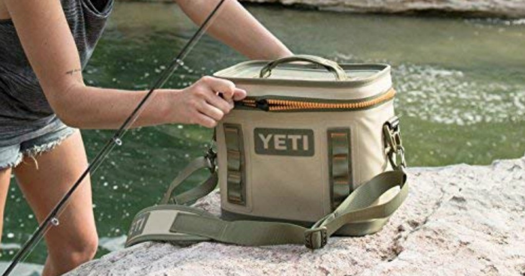 YETI Flip Cooler on ground with person fishing