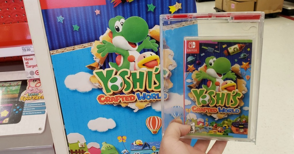 hand holding the Yoshi's Crafted World Nintendo Switch game