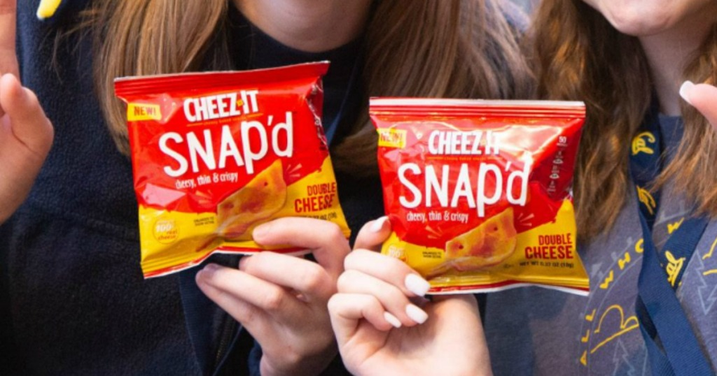 people holding cheez-it snap'd crackers