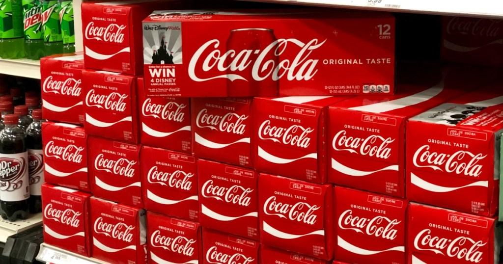 packs of coke on shelf at store