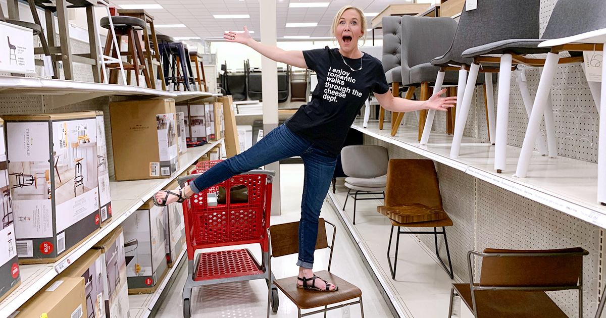 woman standing on chair celebrating in target