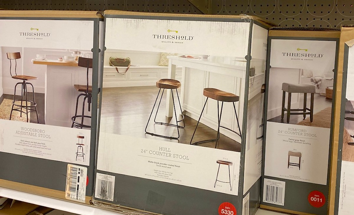 wood and iron counter stools in box on store shelf