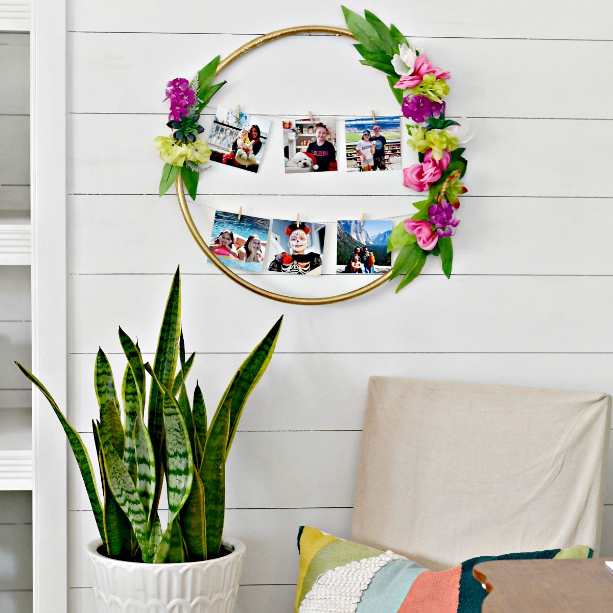 finished photo frame next to a snake plant and covered chair
