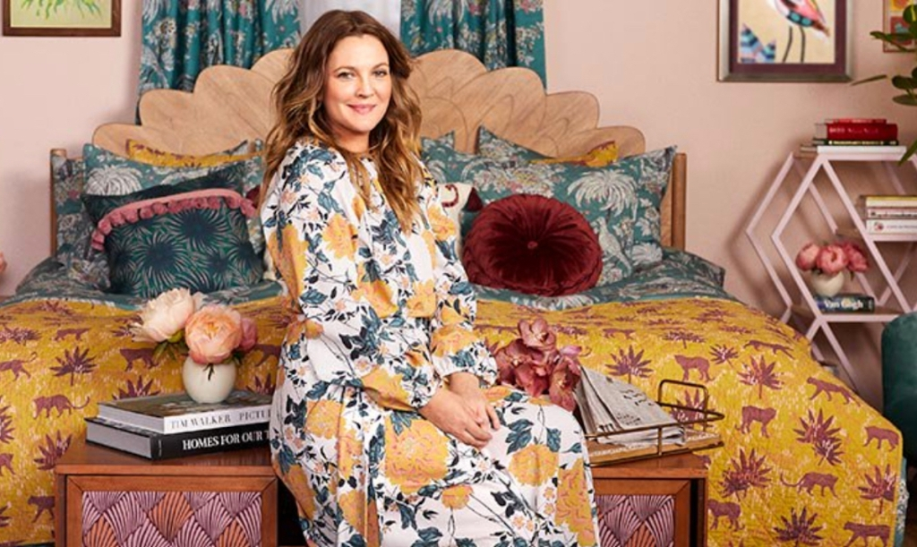 woman sitting on bed with colorful bedding