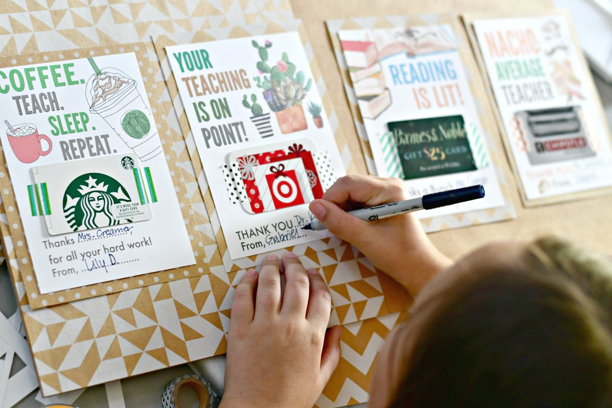 child filling out printable gift card gifts for teachers