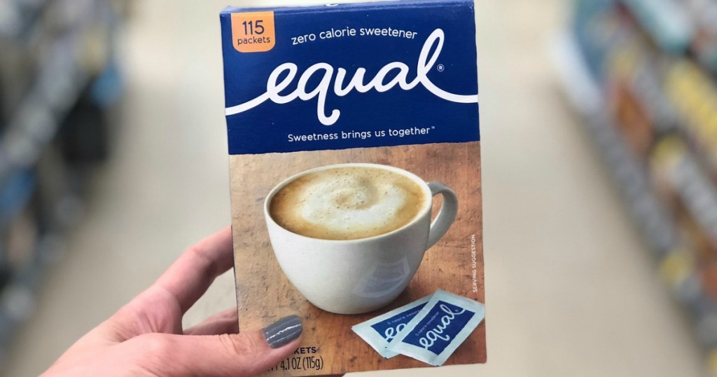 hand holding box of equal sweetener