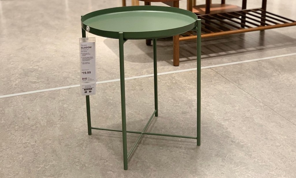 sage green table on concrete floor at ikea