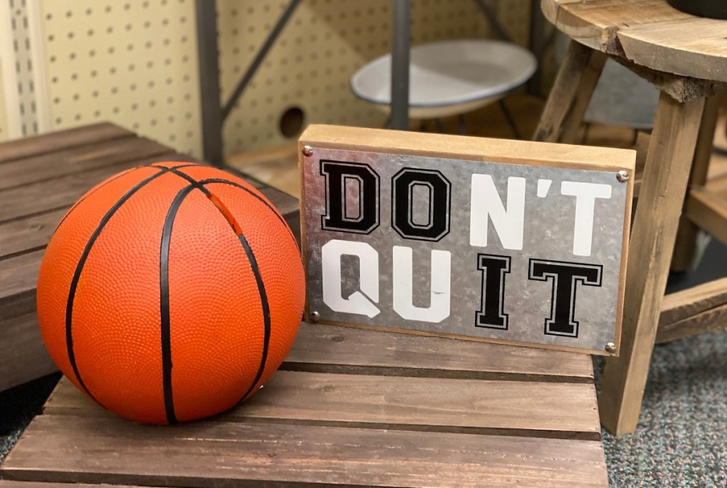 basketball and don't quit sign on wooden table in store - kids decor themes hobby lobby