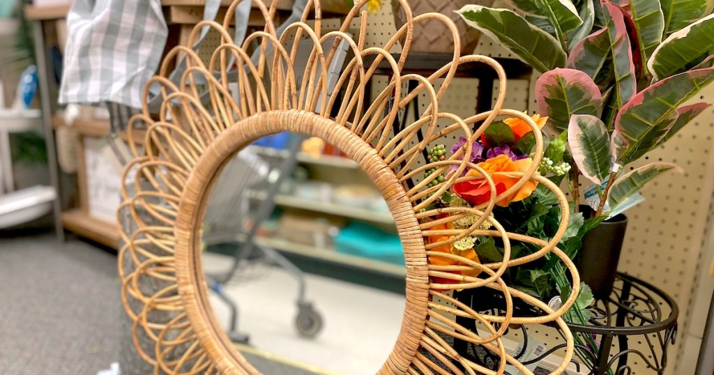 close up of woven rattan mirror on store floor