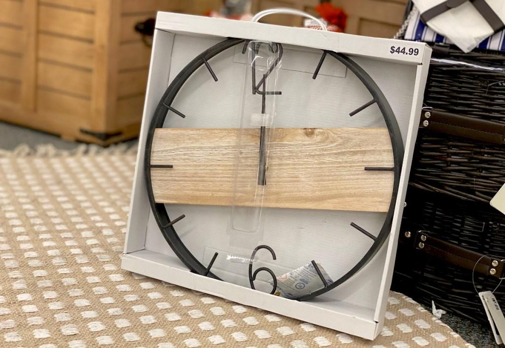 wall clock sitting on jute rug