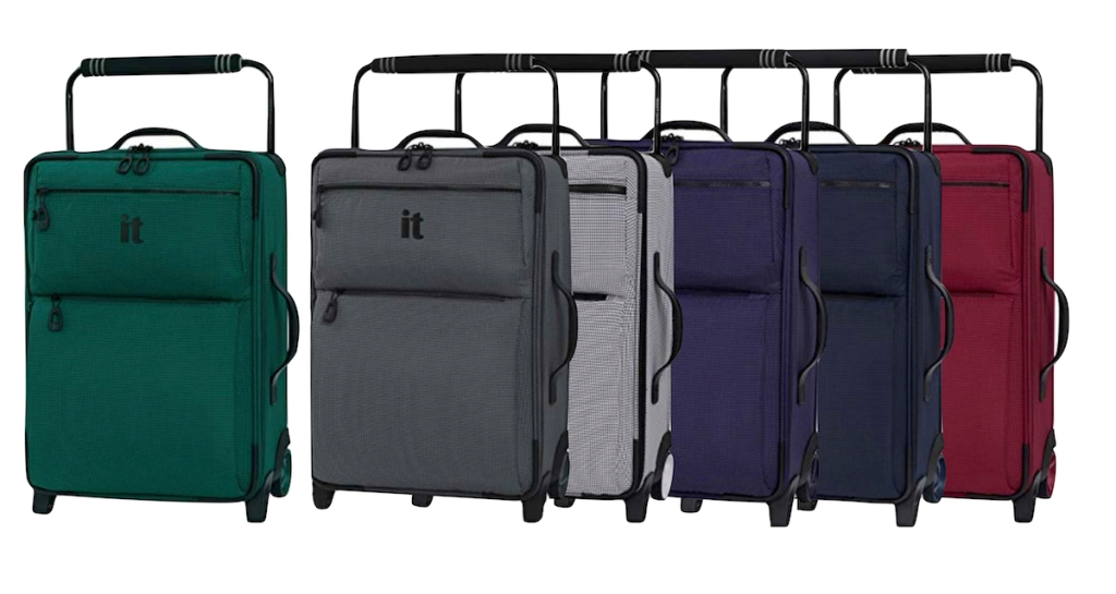 luggage lined up with an it logo on front various color with white background