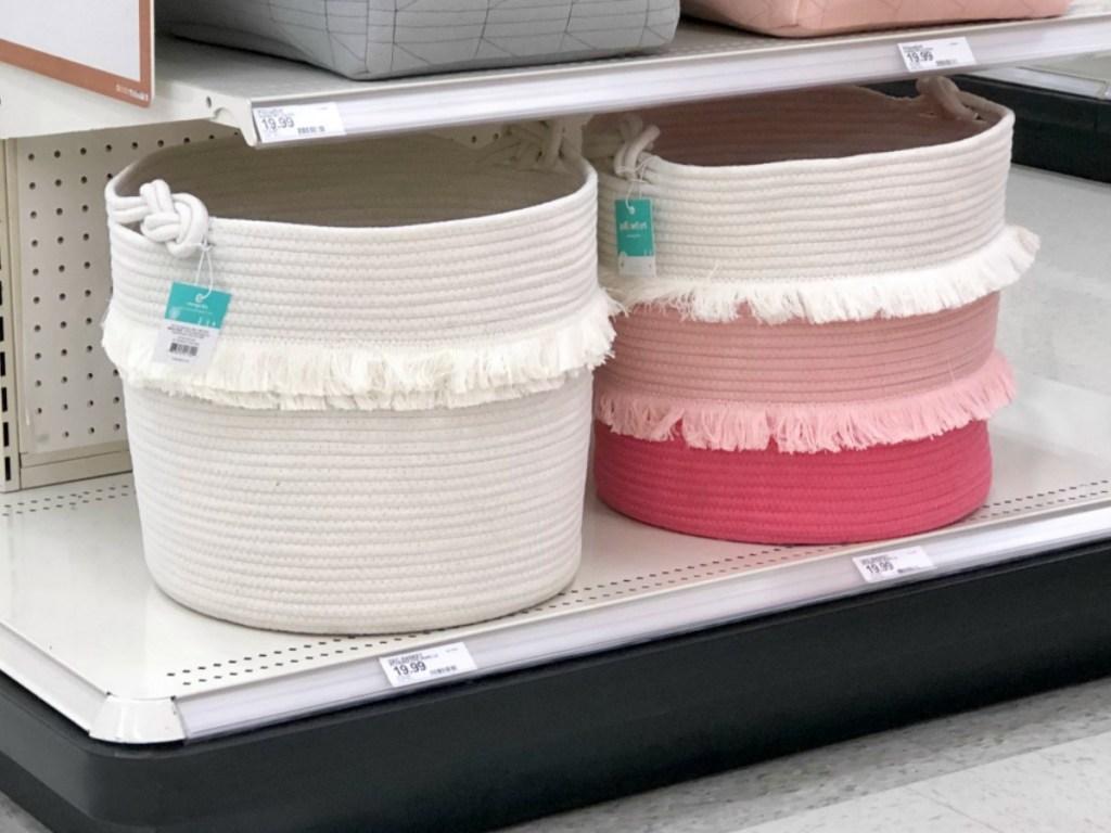 white large coil basket next to pink coil basket at target