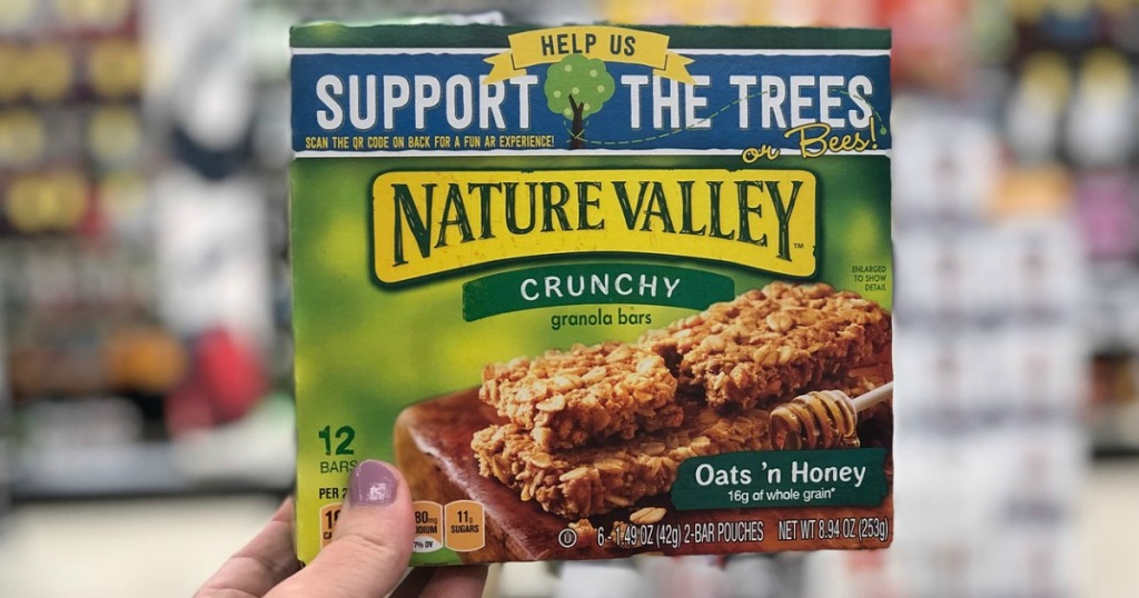 hand holding a box of Nature Valley bars