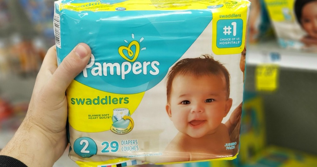 hand holding package of diapers
