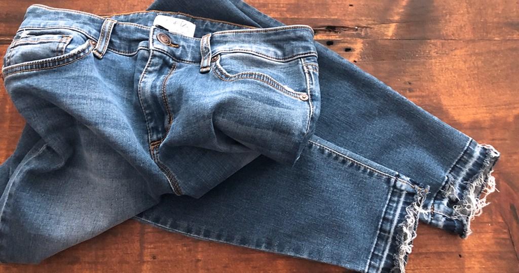 released hem denim diy — original jeans at the end of tutorial