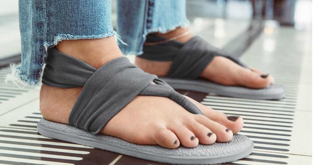 person wearing Sanuk sandals
