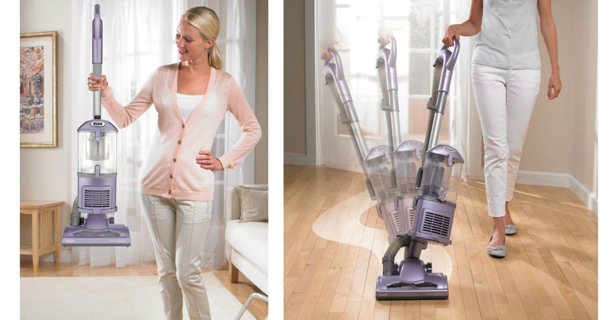 woman holding a lightweight vacuum