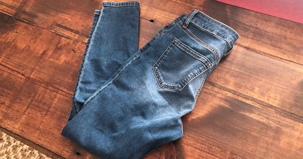 released hem denim diy — jeans at the beginning of the tutorial