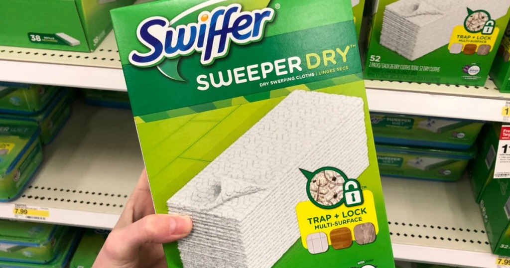 hand holding Swiffer Sweeper Dry Mop box in store