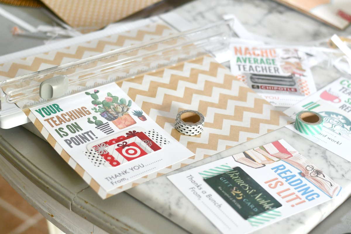 cutting scrapbooking paper with paper trimmer for teacher gift