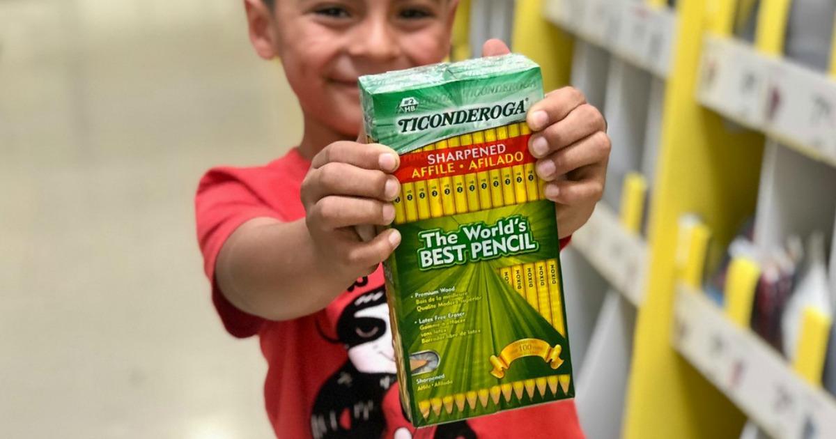 boy holding Ticonderoga pencils