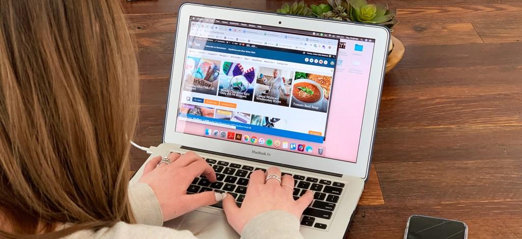 hip2save team member typing on macbook