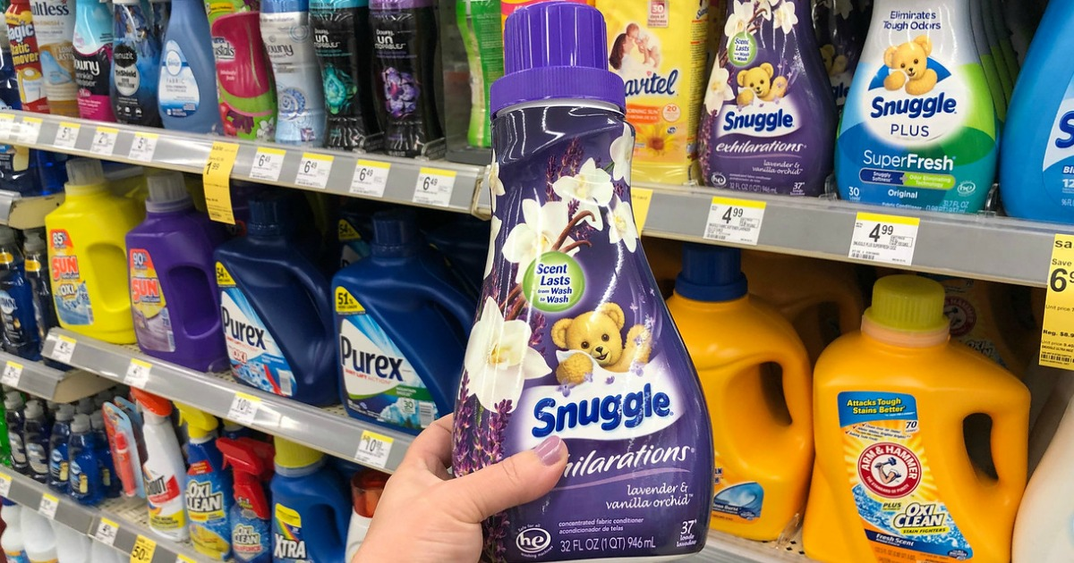 hand holding snuggle exhilarations in lavender in walgreens